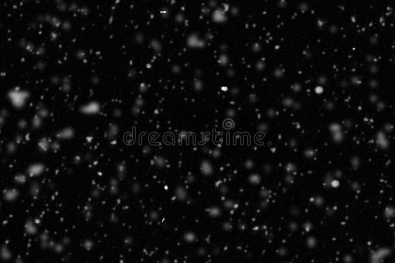 Illustrationsamkopiering av suddig fallande snö arkivfoto