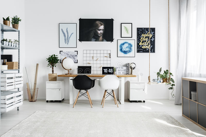 Illustrator artist atelier. In white, with big double desk royalty free stock images