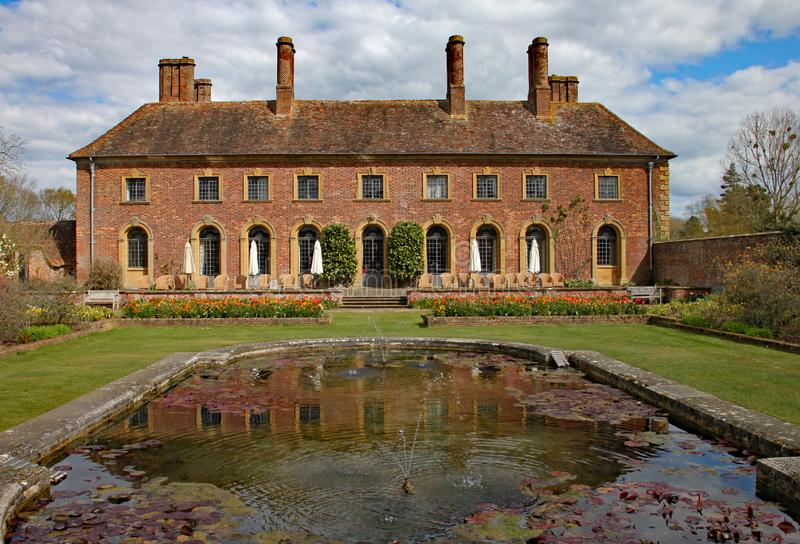 ILMINSTER, SOMERSET, ENGLAND - APRIL 15TH 2012: An English stately home sits behind an ornamental pond.  royalty free stock photo