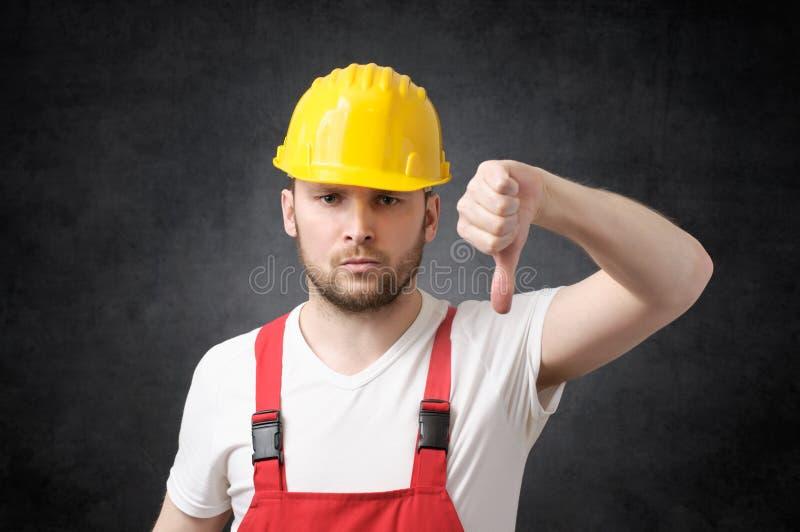 ilsken byggnadsarbetare arkivfoto