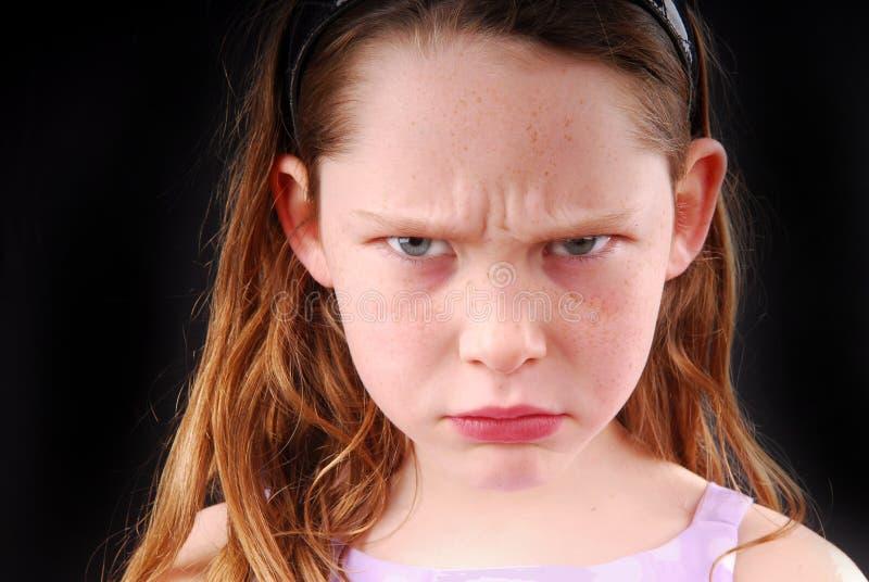 ilsken flicka som ser ung royaltyfria foton