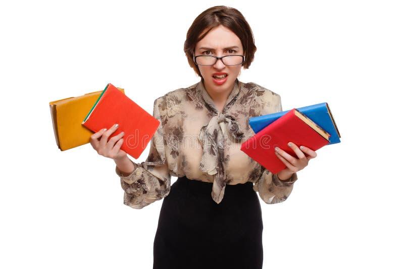 Ilsken flickalärarekvinna i exponeringsglas med böcker arkivfoto