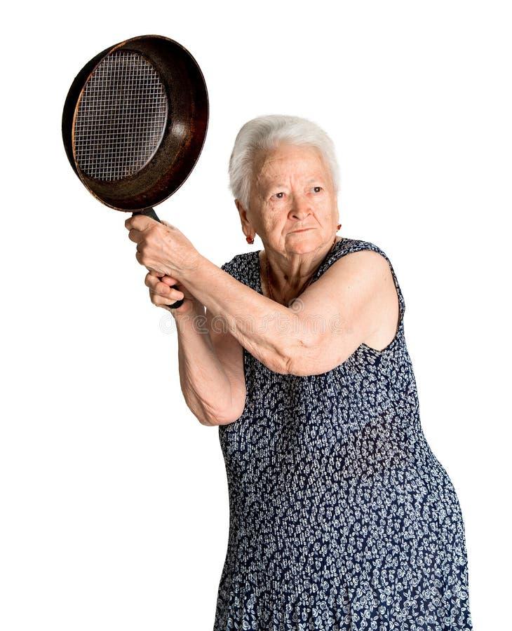 Ilsken gammal kvinna med en panna royaltyfria foton