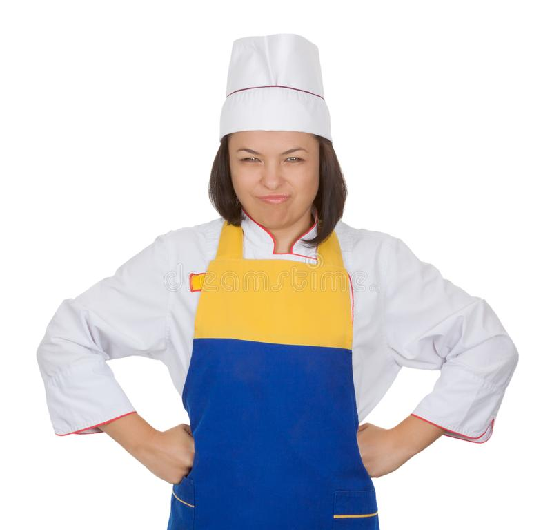 Ilsken härlig kock för ung kvinna i matlagninglikformig fotografering för bildbyråer