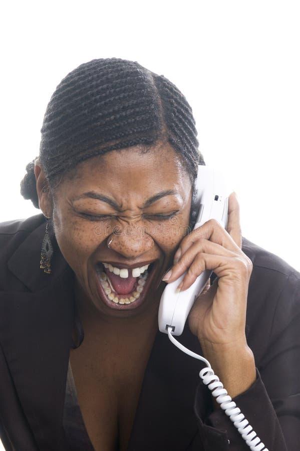 ilsken telefonkvinna royaltyfria bilder