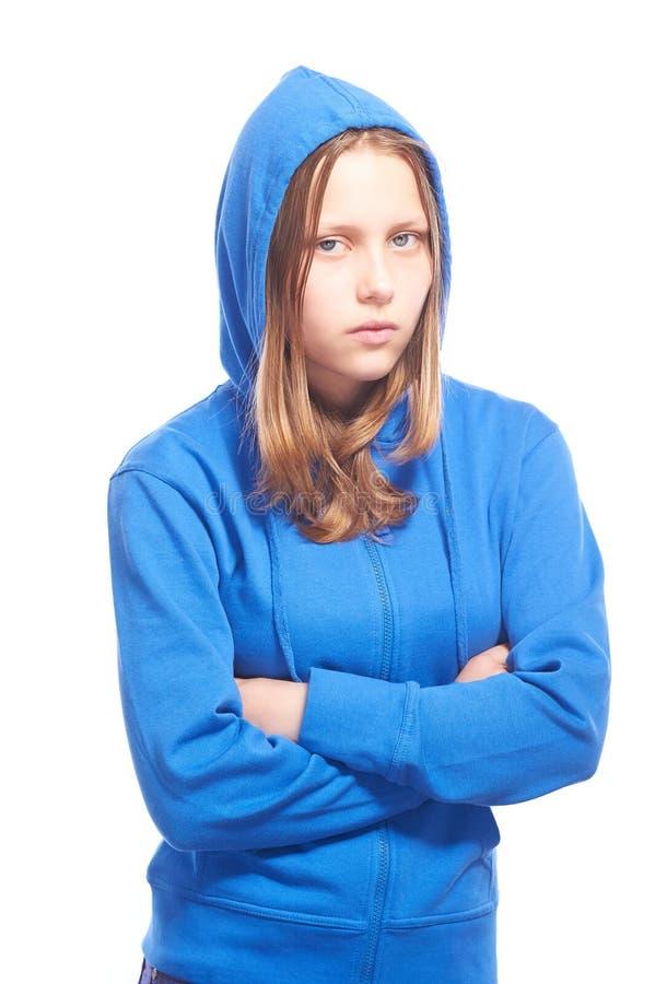 Ilsken tonårig flicka i fattigt royaltyfri bild