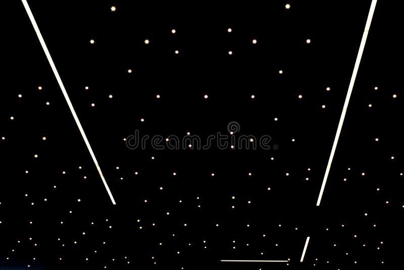 Iluminação sob a forma de um céu estrelado imagem de stock