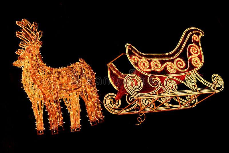 Iluminacje reniferowe z saniem dla Santa Święta dekorują odznaczenie domowych świeżych pomysłów zdjęcie stock