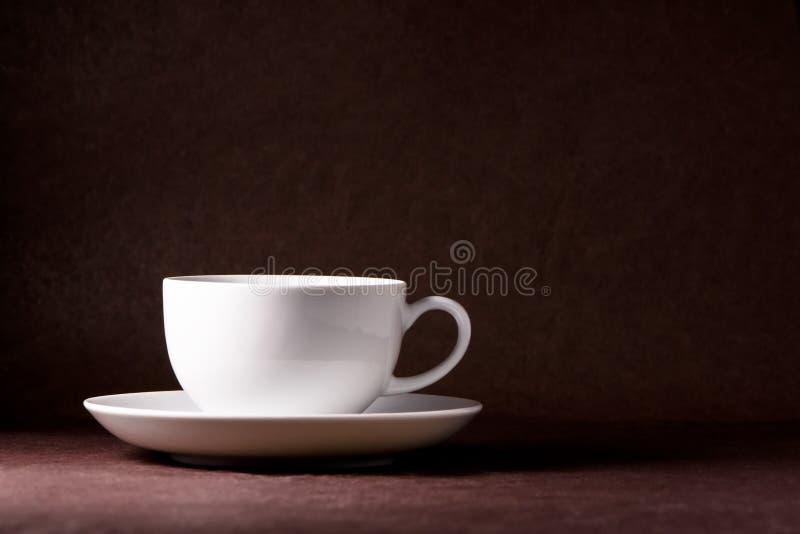 iluminated чашка стоковое изображение