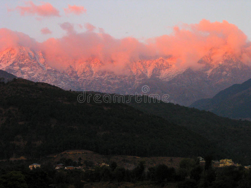 Iluminated and Aflame Himalayas, Kangra India. The seismic zone of Dhauladhar Himalayan ranges come alive and aflame with winter sunsets in Scenic Kangra Valley stock image