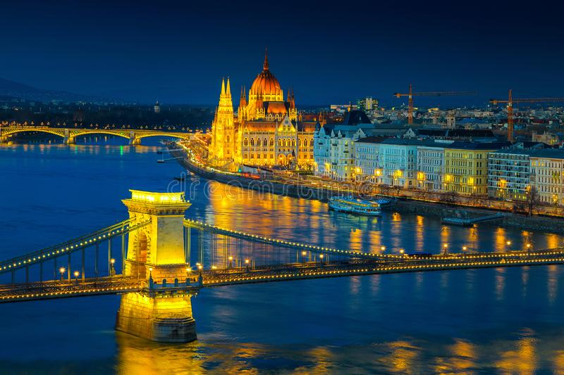 Iluminated Chain bridge and Parliament building at twilight, Budapest, Hungary royalty free stock images