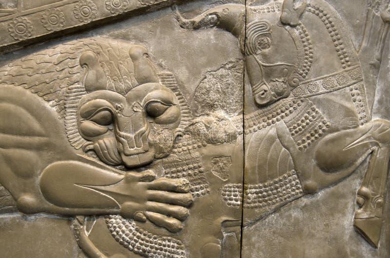 Ilustraciones antiguas de la teja con el león y unicornio en British Museum Londres fotos de archivo