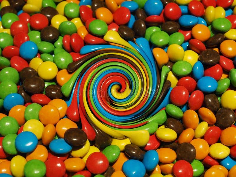 Ilustracja, udzia? kolorowe czekoladowe krople obrazy stock
