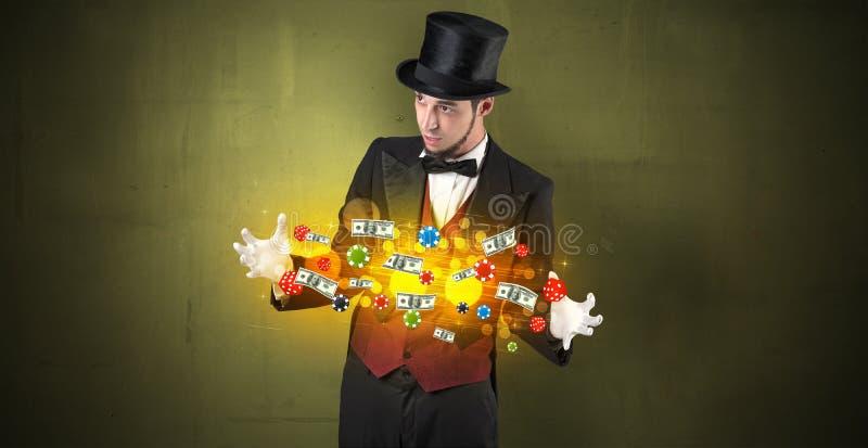 Iluzjonista uprawia hazard personel czaruje z jego ręką obraz royalty free
