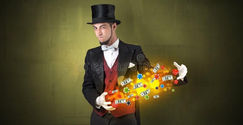 Iluzjonista uprawia hazard personel czaruje z jego ręką zdjęcia royalty free