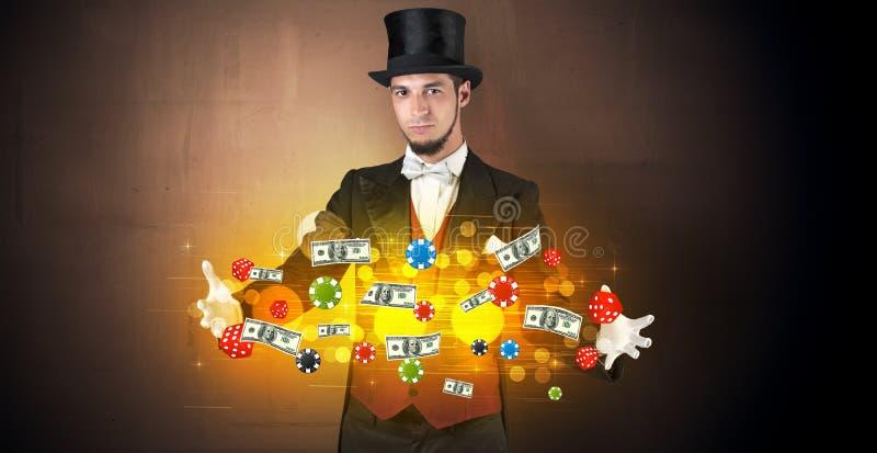 Iluzjonista uprawia hazard personel czaruje z jego ręką obrazy stock