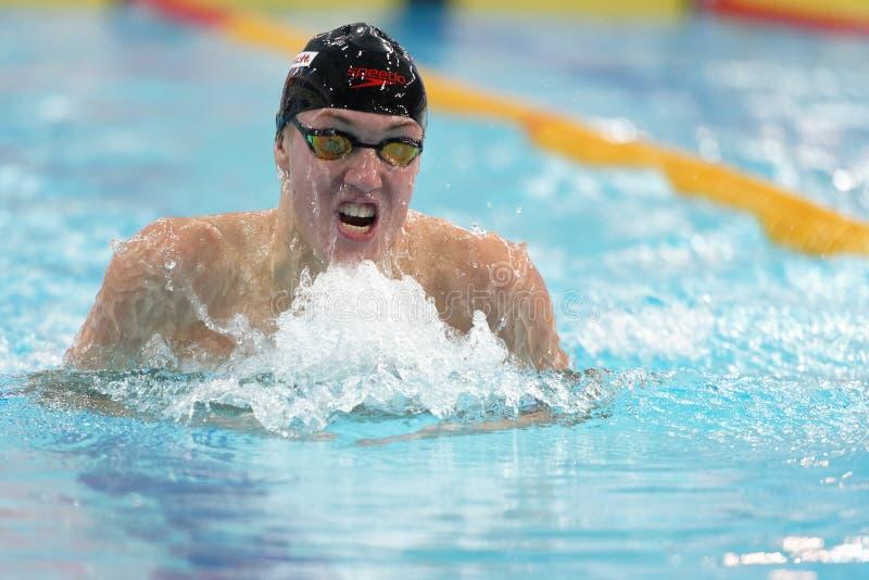 Ilya Shymanovich, Wit-Rusland in mensenschoolslag het zwemmen competities stock afbeelding