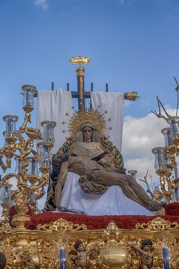 Imágenes de la semana santa en Sevilla, fraternidad del mercado imagenes de archivo