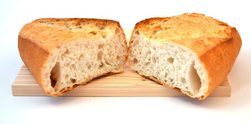 Imágenes del pan y del cuchillo del trigo integral del desayuno fotografía de archivo libre de regalías
