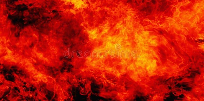 Imágenes dramáticas del fondo de la llama del fuego como símbolo del infierno y del dolor eterno en la tradición cristiana foto de archivo libre de regalías