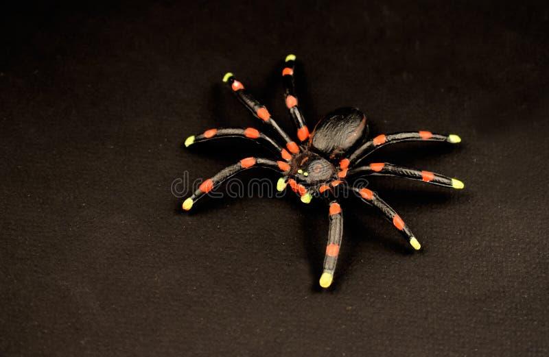 Imágenes negras de la acción del juguete de la araña fotos de archivo libres de regalías
