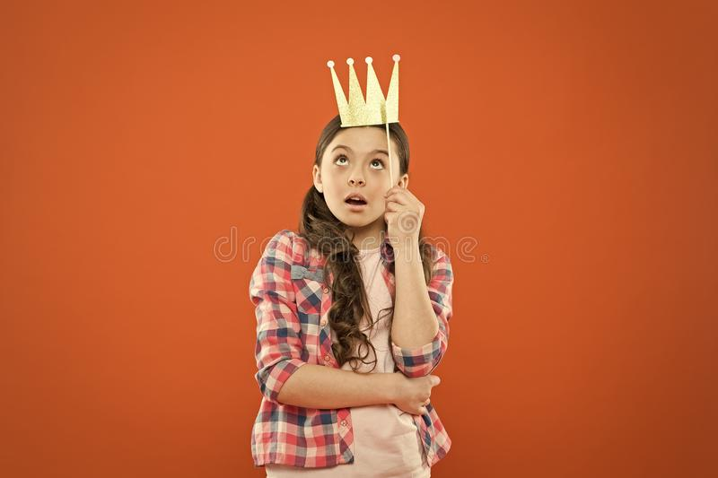 Im a big boss here. Little big boss on orange background. Cute girl boss wearing prop crown. Small happy child with big royalty free stock photography