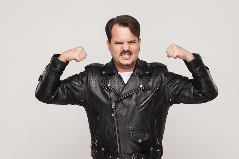 Im strong! Man posing and showing biceps royalty free stock image