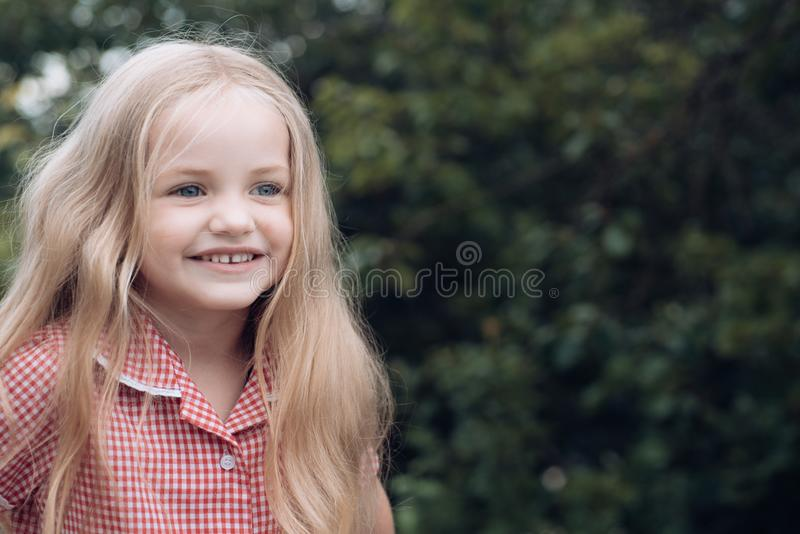 Im too happy being myself. Small child happy smiling. Little girl with blond hair. Small girl wear long hair. Happy royalty free stock photography