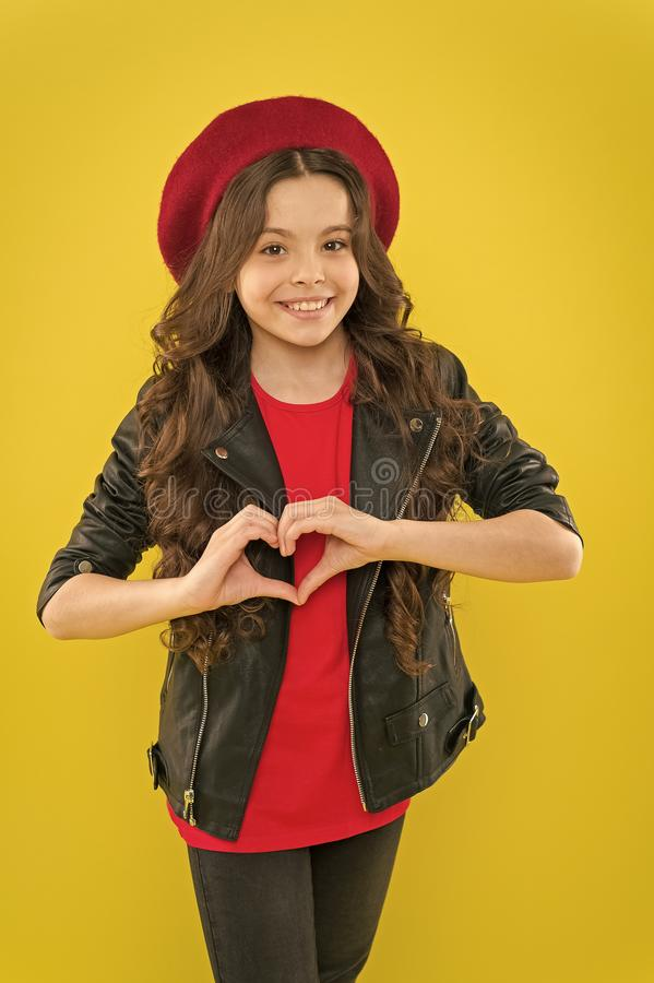 Im the valentines thief and Im here to steal your heart. Little child smiling with hand heart gesture on valentines day. Happy small girl inviting to stock images