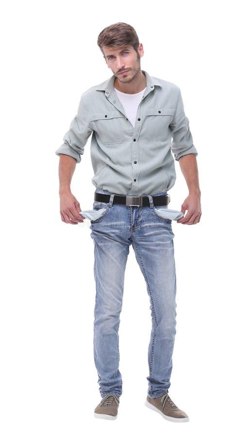 Im vollen Wachstum Junger Mann, der seine leeren Taschen zeigt lizenzfreie stockfotografie