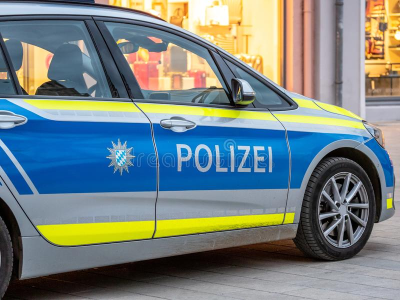 Imaga of a german police car from the state of bavaria with the letters polizei on the door. Imaga of a german police car in blue and yellow stripes from the stock photography