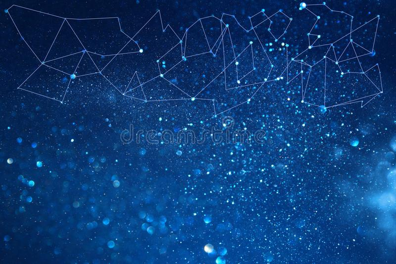 image of abstract connected dots on bright glittery blue background. Technology concept. stock photos