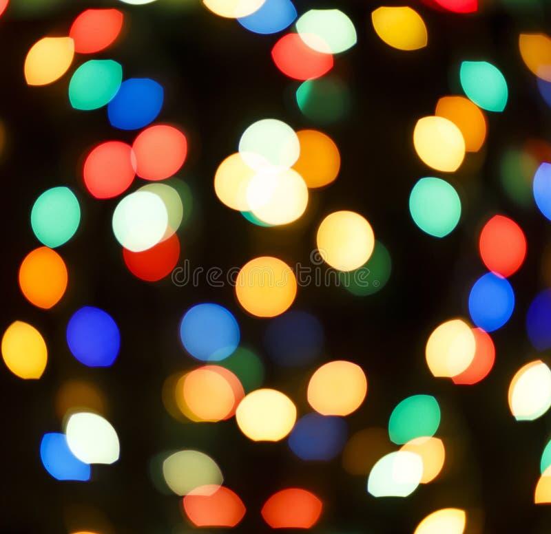 Image abstraite Bokeh multicolore sur un fond noir photos libres de droits