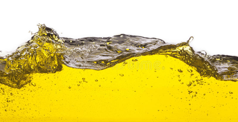 Image abstraite d'un liquide jaune renversé photographie stock libre de droits