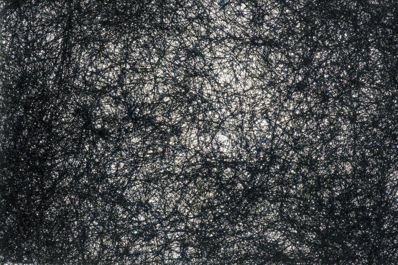 Image abstraite d'une pluralité de brins noirs entrelacés image libre de droits