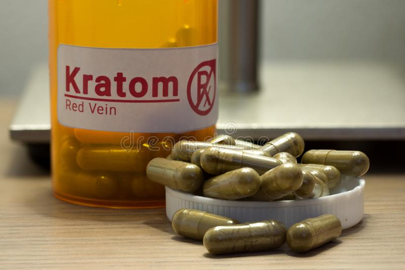 Kratom pills on a desk. Image of actual kratom pills with a faux prescription logo royalty free stock images