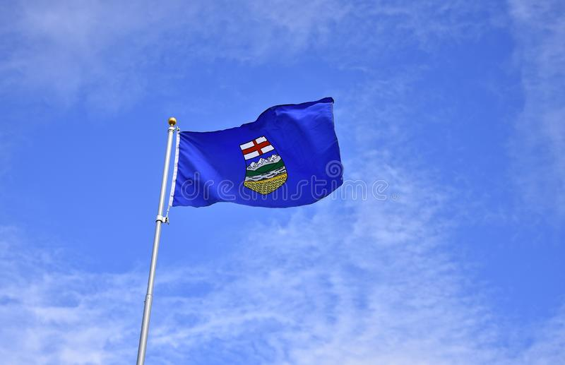 Alberta Provincial Flag. An image of an Alberta provincial flag waving in the wind royalty free stock photos