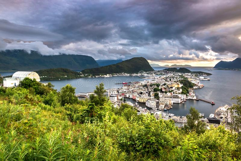Aerial View of Alesund Center at Dramatic Sunset. Image of Alesund at dramatic sunset in Summer taken from Mount Aksla Viewpoint. Alesund is a port town on the royalty free stock images