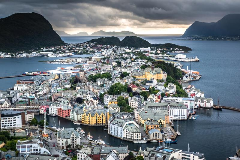 Aerial View of Alesund Center with Dramatic Sky after A Rain. Image of Alesund after the rain in Summer taken from Mount Aksla Viewpoint. Alesund is a port town royalty free stock image