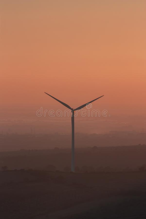 An image of amazing wind turbine with beautiful sky. Wind turbine silhouette at the sunset time generator propeller recycling alternative blue cloudscape color stock images