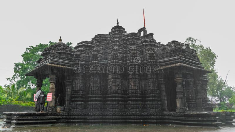 Image of Ambreshwar Shiv Temple In Heavy Rain, Full shot, Historic 11th-century Hindu temple royalty free stock photo