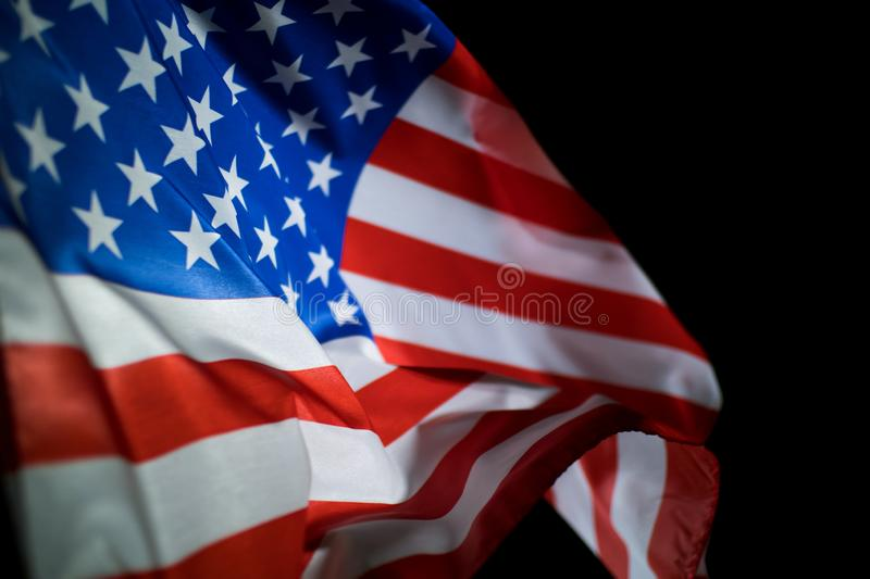 Image of American flag blowing in the wind for Independence day and Memorial day stock images