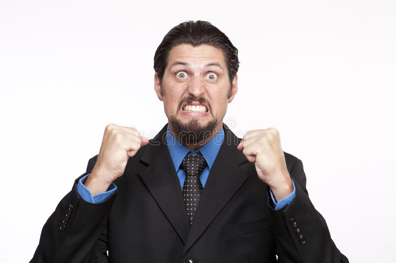 Image of a angry young businessman with clenched fist stock images
