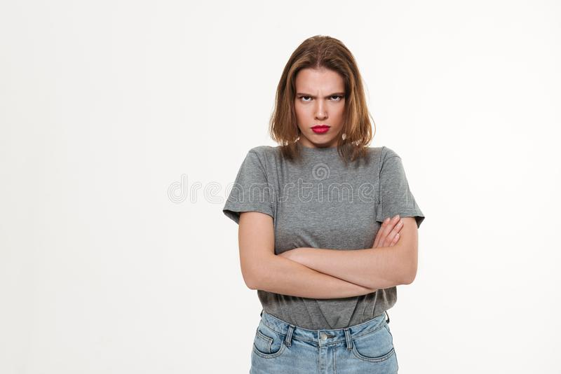 Angry young caucasian lady with arms crossed. stock images