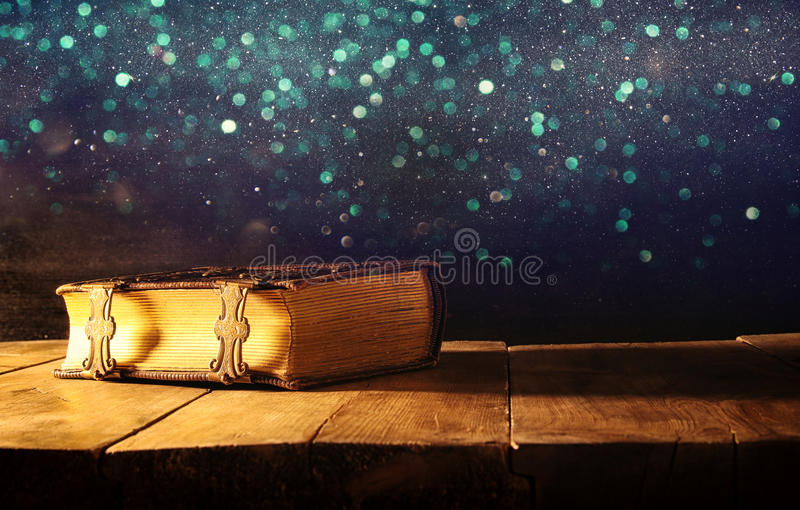 Image of antique books, with brass clasps. fantasy medieval period and religious concept. Image of antique books, with brass clasps on old wooden table. fantasy stock photos