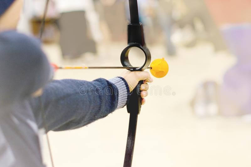 Image of Archer holds his bow aiming at a target stock images