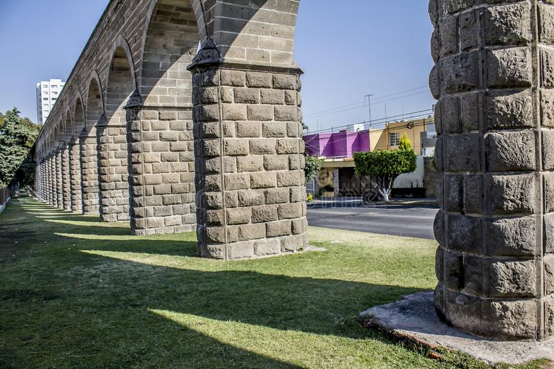 Beautiful image of the arches of a stone aqueduct. Image of the arches of a stone aqueduct on a wonderful sunny day in Guadalajara Jalisco Mexico stock photos