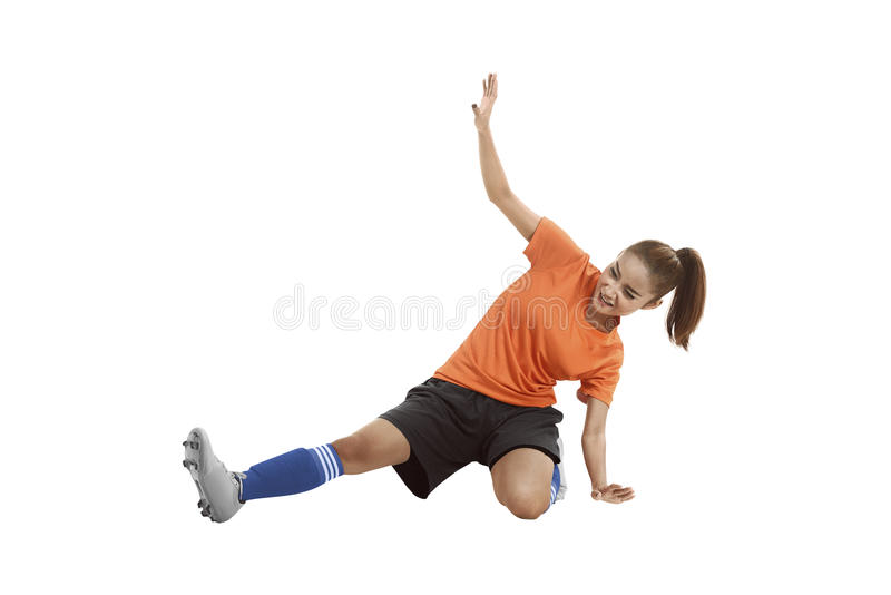 Image of asian football player sliding tackle. Isolated over white background stock photo