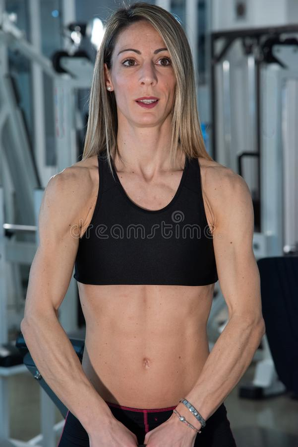 Woman in the gym doing exercises in the gym. stock images