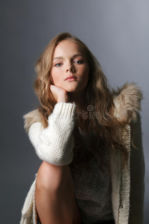Image of attractive young model posing in sweater stock images